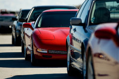 Red Sports Car in a Traffic Jam. Stock Photos