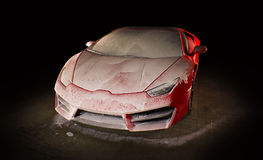 Red sports car wash - dark background. Red italian sports car being washed in dark place royalty free stock images