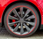 Red sports car wheel. Royalty Free Stock Image