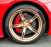 Red sports car wheel. Royalty Free Stock Photos
