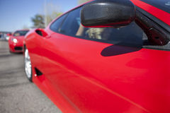 Red sports car wing mirror Stock Photography