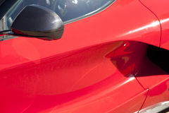 Red sports car wing mirror. Detail of a luxury car Royalty Free Stock Photography