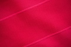 Sports clothing fabric jersey texture. Red sports clothing fabric jersey texture Stock Photography