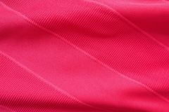 Sports clothing fabric jersey texture. Red sports clothing fabric jersey texture Stock Images