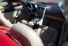 Red sports convertible car interior. Detail of a luxury car with clear leather fair Royalty Free Stock Image
