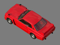 Red sports coupe. Red race car. Retro race. Japanese School tuning. Uniform gray background. Three-dimensional model. Raster illus Stock Image