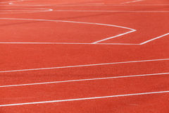 Red sports ground with white marking Stock Photo