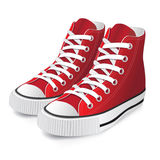 Red sports shoes. On a white background Royalty Free Stock Photos