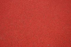 Red sports surface. Red field with synthetic turf as sports background Royalty Free Stock Images