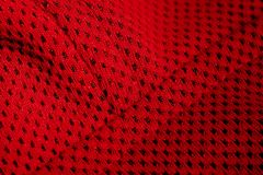 Red sportswear closeup top view. seam and juncture. breathable knitwear. clothing details macro stock photos