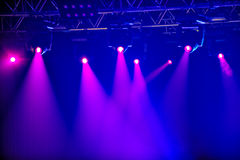 Red stage spotlights. Red spotlights on empty stage royalty free stock image