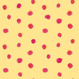 Red spots pattern on yellow background. Abstract seamless pattern with red spots on yellow background Stock Photos