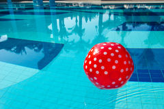 Red spotted beach ball in the swimming pool Stock Photography