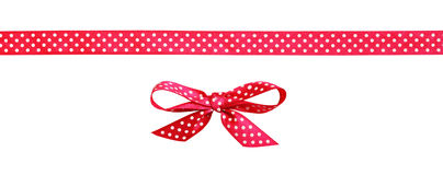 Red spotted bow and ribbon Royalty Free Stock Photo