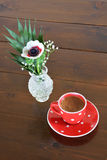 Red spotty mug and anemone Stock Photos