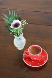 Red spotty mug and anemone Stock Photos