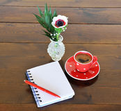 Red spotty mug and note book Royalty Free Stock Photos