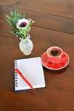 Red spotty mug and note pad Royalty Free Stock Photos