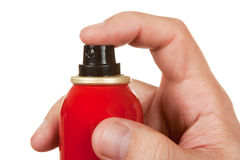 Red spray bottle in his hand Stock Photo