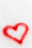 Red sprayed heart in the snow Stock Photo