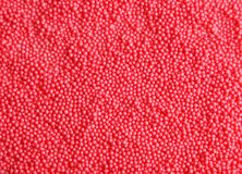 Red sprinkles background, close up Royalty Free Stock Images