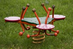 Red sprung teeter totter for kids royalty free stock images