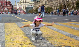 Red square moscow. Little girl travels to Moscow on Red Square Stock Images