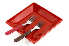 Red square plate and two forks Royalty Free Stock Images