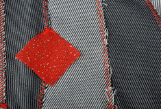 Red square on textile background Royalty Free Stock Images