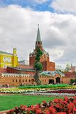 Red Square, Trinity Tower of the Moscow Kremlin. Russia. Red Square, Trinity Tower of the Moscow Kremlin. Lawn and flower beds with flowers. Russia Stock Photos