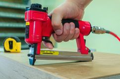 Red sroiteny pneumatic stapler royalty free stock images