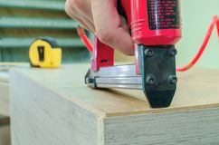 Red sroiteny pneumatic stapler royalty free stock image