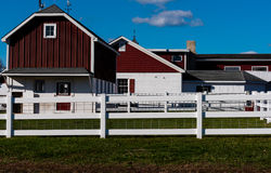 Red Stables and Barn. Red and white barn and stables for a horse farm Royalty Free Stock Image