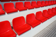 Red stadium seats Stock Photos