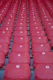 Red stadium seats. Empty red plastic seats in a stadium Stock Photo