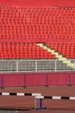 Red stadium seats. Empty red plastic seats in a stadium Stock Image