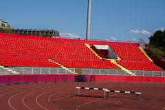 Red stadium seats. Empty red plastic seats in a stadium Royalty Free Stock Images
