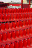 Red stadium seats. Empty red plastic seats in a stadium Stock Photography