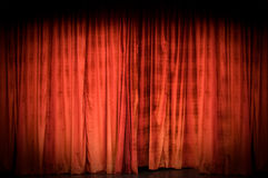 Red stage curtain. Closed red curtain as background Stock Image