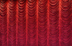Red Stage Curtain. With lights shining on it Royalty Free Stock Photos