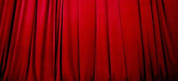 Red Stage Curtain. Beautiful red stage curtain with soft focus Royalty Free Stock Images