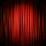 Red stage curtain illuminated by spotlight Stock Image