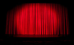 Red stage curtain with spotlight. And with contours of seats Stock Photography