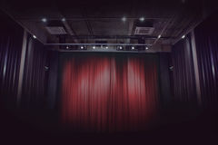 Red stage curtain in theater Stock Images