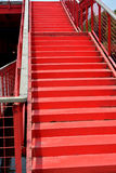 Red stage with handrail. Stage with handrail in red color, shown as composition by shape and color in architecture pattern Royalty Free Stock Photos