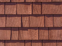 Red Stained Cedar Shingles. Red stained cedar wood shingles background texture Stock Photography