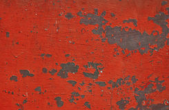 Red stained rusty painted metal surface with flakes Royalty Free Stock Photos