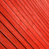 Red stained timber slats as abstract pattern background Stock Photography