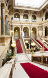 Red staircase. Marble staircase and main hall of palace Stock Photo