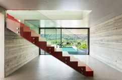 Red staircase. Interior, red staircase in modern villa Stock Image
